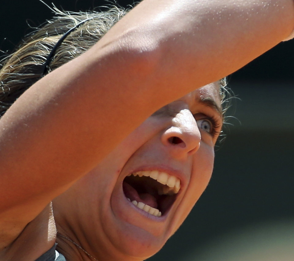 Photo - Italy's Sara Errani celebrates after winning her semifinal match against Serbia's Jelena Jankovic at the Italian open tennis tournament in Rome, Saturday, May 17, 2014. Sara Errani became the first home player to reach the Italian Open final in nearly 30 years with a 6-3, 7-5 win over sixth-seeded Jelena Jankovic on Saturday. (AP Photo/Gregorio Borgia)