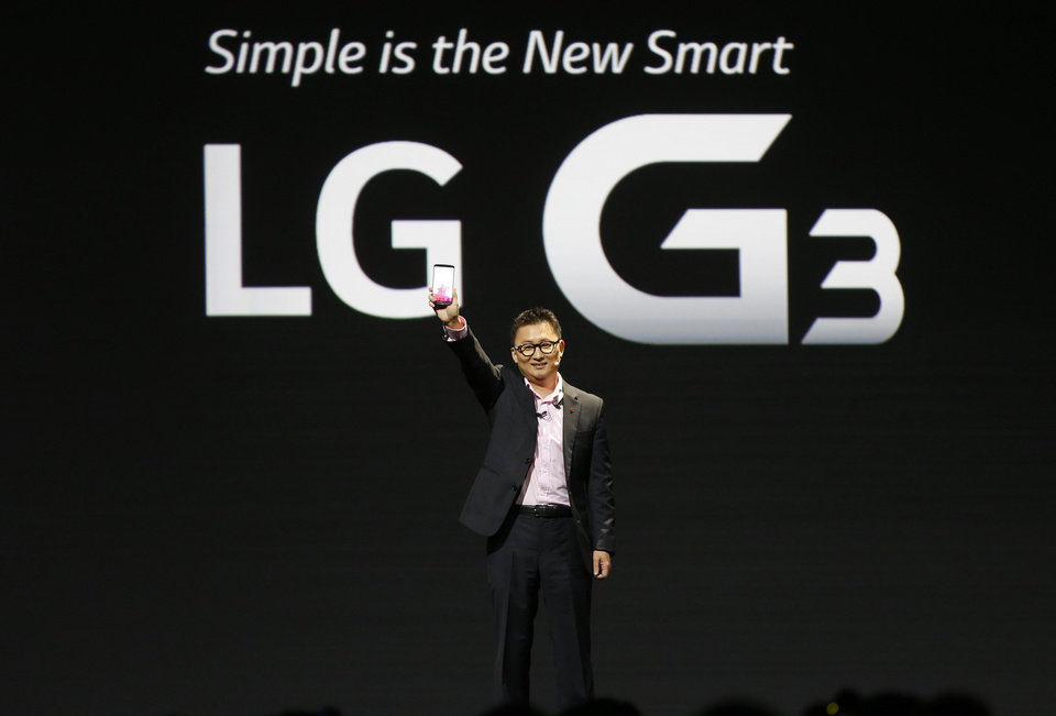 Photo - Dr. Ramchan Woo, Head of Smartphone Planning for LG, unveils the company's new smartphone called the G3 at a press event in London, Tuesday, May 27, 2014. (AP Photo/Lefteris Pitarakis)