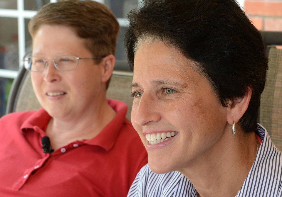 Photo - Deb,left, and Susan Whitewood smile at their home in South Fayette, Pa,., Tuesday, May 20, 2014, as they await the decision of a federal judge in Harrisburg who is expected to rule Tuesday on a challenge to the state's 1996 Defense of Marriage Act. (AP Photo/Pittsburgh Post-Gazette, Bob Donaldson)  MAGS OUT; NO SALES; MONESSEN OUT; KITTANNING OUT; CONNELLSVILLE OUT; GREENSBURG OUT; TARENTUM OUT; NORTH HILLS NEWS RECORD OUT; BUTLER OUT