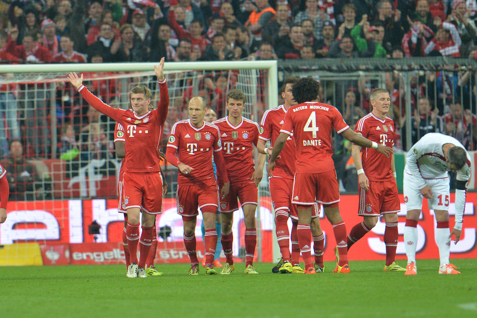 Photo - Munich's scorer Toni Kroos, left, celebrates after scoring during the German soccer cup (DFB Pokal) semifinal match between FC Bayern Munich and FC Kaiserslautern in the Allianz Arena in Munich, Germany, on Wednesday, April 16. 2014. (AP Photo/Kerstin Joensson)
