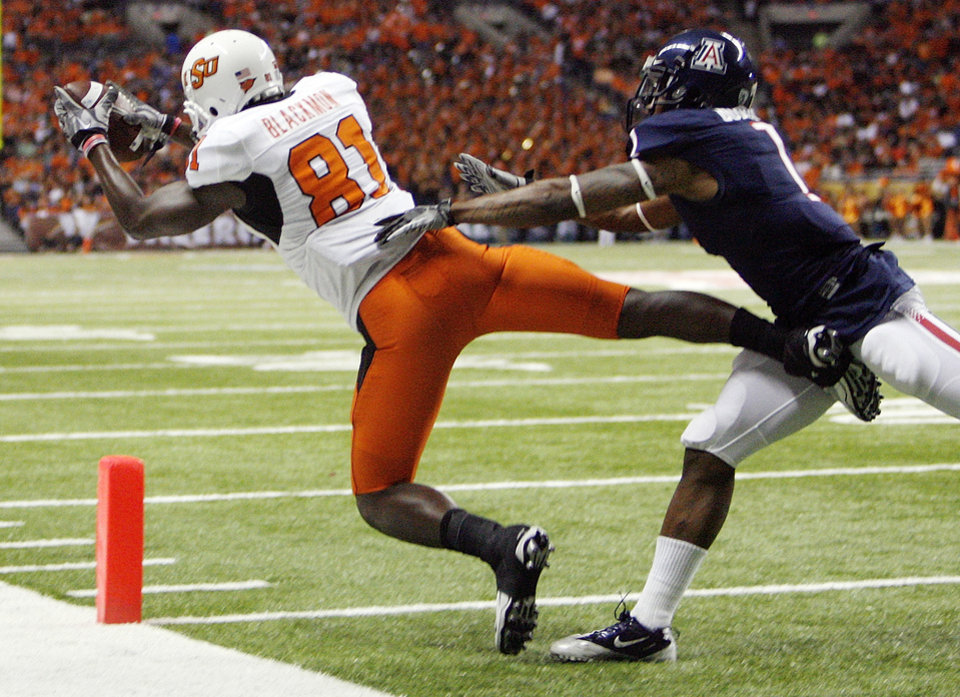 OSU's Justin Blackmon (81) makes a touchdown catch as Robert Golden (1) of Arizona defends in the third quarter during the Valero Alamo Bowl college football game between the Oklahoma State University Cowboys (OSU) and the University of Arizona Wildcats at the Alamodome in San Antonio, Texas, Wednesday, December 29, 2010. OSU won, 36-10. Photo by Nate Billings, The Oklahoman