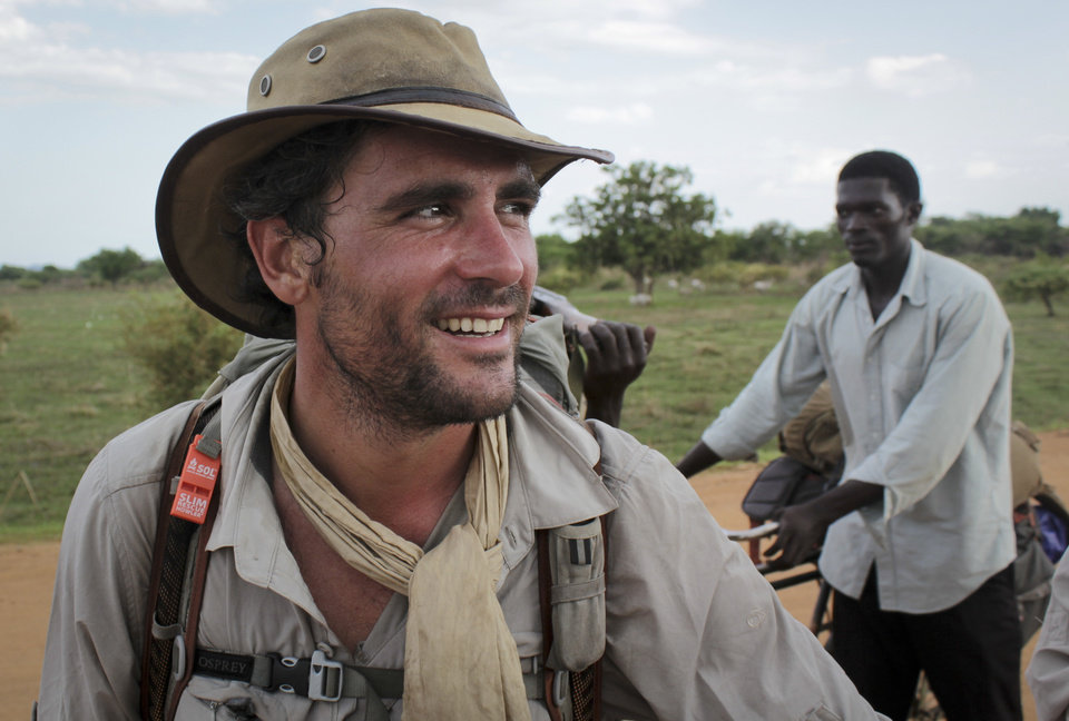 Photo - In this photo taken Wednesday, April 9, 2014, former British Army captain Levison Wood sets out walking along the Nile river from Juba, in South Sudan. Close calls with crocodiles and a brutal civil war have not deterred Levison from attempting to walk the length of the Nile, a 4,250 mile journey along the world's longest river that will see him pass through seven countries. (AP Photo/Ilya Gridneff)