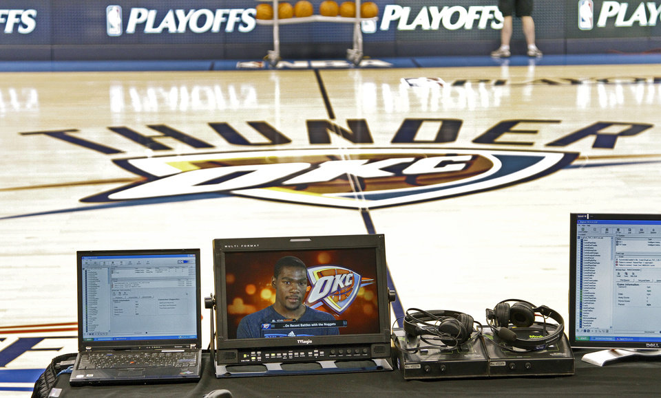 Kevin Durant is seen on a monitor at court side of the Oklahoma City Arena before the start of the first round NBA playoff game between the Oklahoma City Thunder and the Denver Nuggets on Sunday, April 17, 2011, in Oklahoma City, Okla. Photo by Chris Landsberger, The Oklahoman