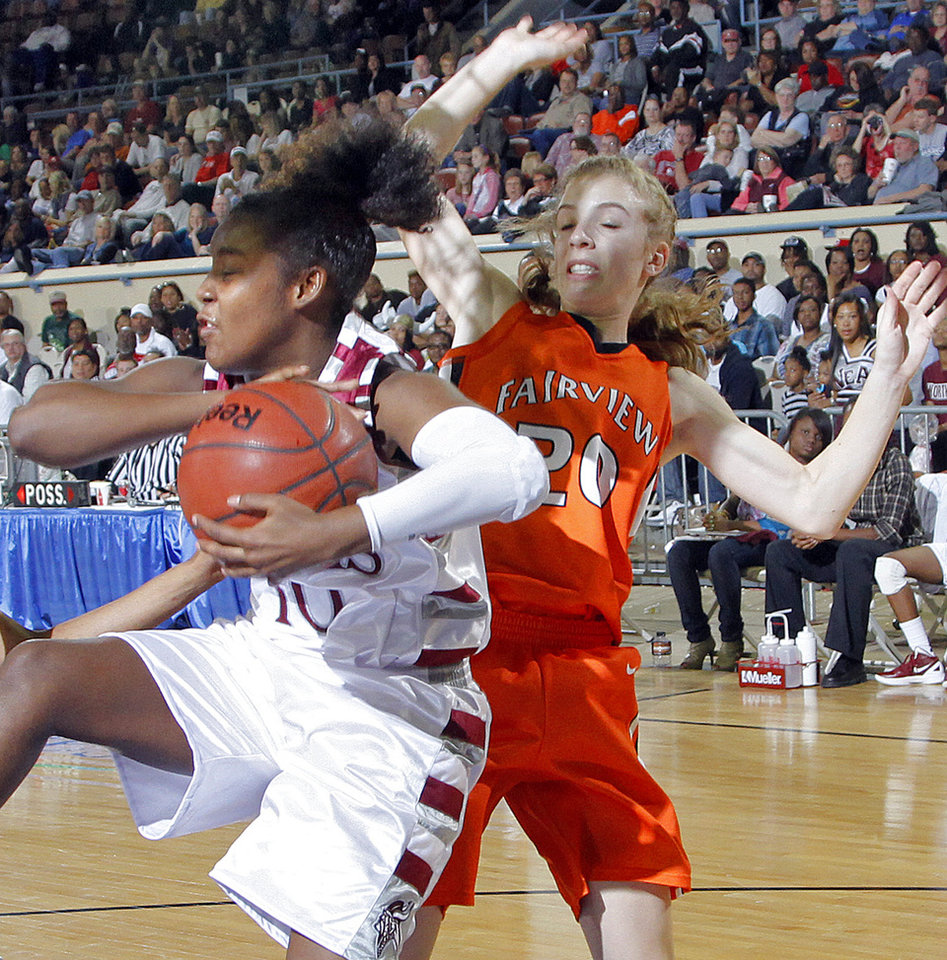 Northeast's T'ona Edwards (10) pulls in a rebound over Fairview's Abby Smith (20) during the 2A girls State Basketball Championship game between Northeast High School and Fairview High School at State Fair Arena on Saturday, March 10, 2012 in Oklahoma City, Okla.  Photo by Chris Landsberger, The Oklahoman