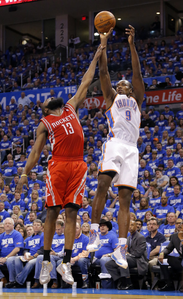Photo - Oklahoma City's Serge Ibaka (9) is fouled by Houston's James Harden (13) during Game 1 in the first round of the NBA playoffs between the Oklahoma City Thunder and the Houston Rockets at Chesapeake Energy Arena in Oklahoma City, Sunday, April 21, 2013. Photo by Sarah Phipps, The Oklahoman