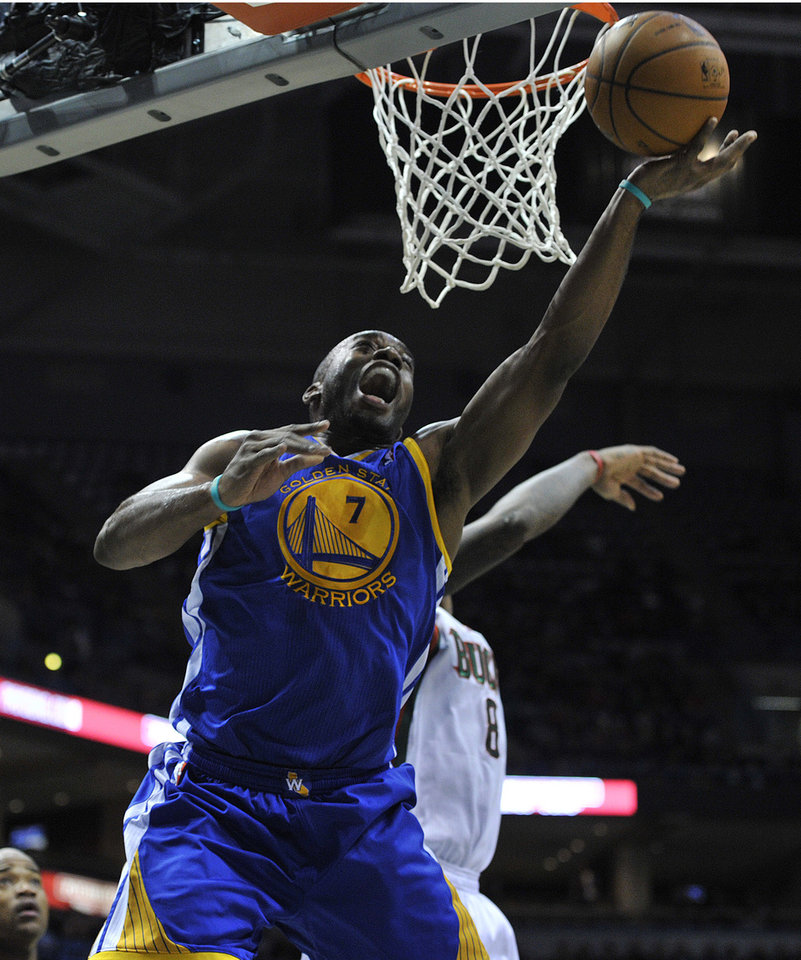 Golden State Warriors' Carl Landry (7) shoots over the Milwaukee Bucks' Larry Sanders during the first half of an NBA basketball game on Saturday, Jan. 26, 2013, in Milwaukee. (AP Photo/Jim Prisching)