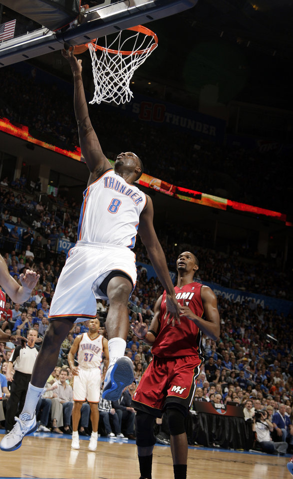 Photo - Oklahoma City's Nazr Mohammed (8) dunks Miami Heat's Chris Bosh (1) during the NBA basketball game between the Miami Heat and the Oklahoma City Thunder at Chesapeake Energy Arena in Oklahoma City, Sunday, March 25, 2012. Photo by Sarah Phipps The Oklahoman
