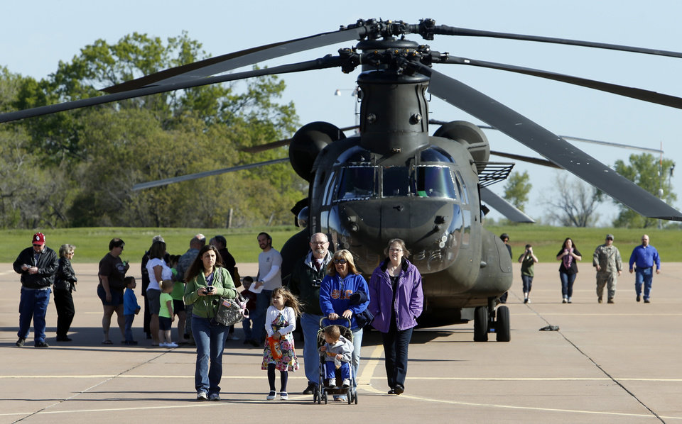 Families get a tour of helicopters before a deployment ceremony for Detachment 1, Company B, 2nd Battalion, 149th General Support Aviation Battalion (GSAB), as they prepare for deployment to Afghanistan in support of Operation Enduring Freedom on Thursday, April 25, 2013 in Lexington, Okla. Photo by Steve Sisney, The Oklahoman