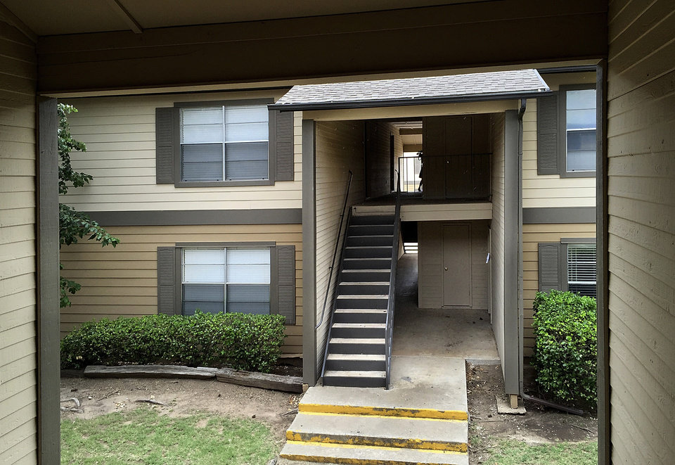 Photo - Homicide occurred at the apartment at upper left , #514, in Building 5, at the Cambridge Landing Apartments. The mother of an 8-month-old boy who was stabbed to death in southwest Oklahoma City early Monday, July 11, 2016,  has been arrested on complaints of homicide and assault with a deadly weapon on two others, police report. About 12:30 a.m., police responded to an assault with a deadly weapon report in the 8800 block of S Drexel Ave. at the Cambridge Landing Apartments.The baby, Ezekeil Veloz, suffered fatal stab wounds. His mother, Raven Veloz, 21, was taken into custody at the scene. A 4-year-old girl and a 28-year-old man also suffered stab wounds, police report. Raven Veloz suffered self-inflicted knife wounds as well and was hospitalized Monday morning, police report. The baby was dead at the scene. Photo by Jim Beckel, The Oklahoman