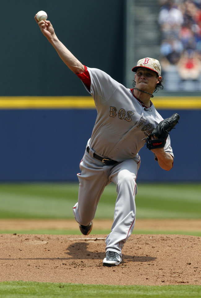 Photo - Boston Red Sox's Clay Buchholz (11) pitches against the Atlanta Braves during the first inning of a baseball game on Monday, May 26, 2014, in Atlanta, Ga. (AP Photo/Butch Dill)