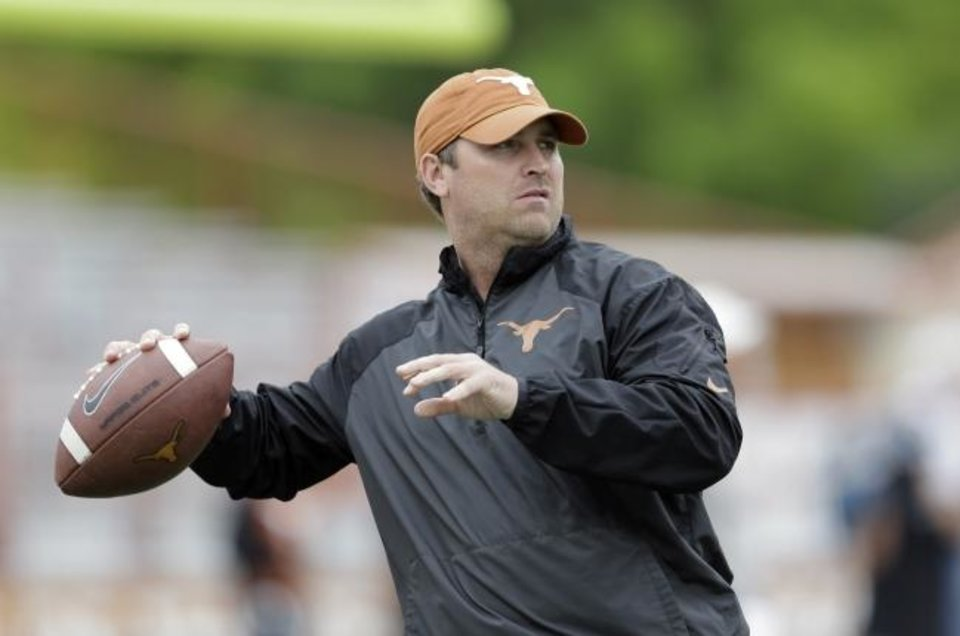 Photo -  Sterlin Gilbert, now the first-year head coach at McNeese State, was hired to be the Texas offensive coordinator in 2016. After only a season, Charlie Strong's entire staff was fired. Still, Gilbert doesn't regret his decision to go to Austin. [AP PHOTO]