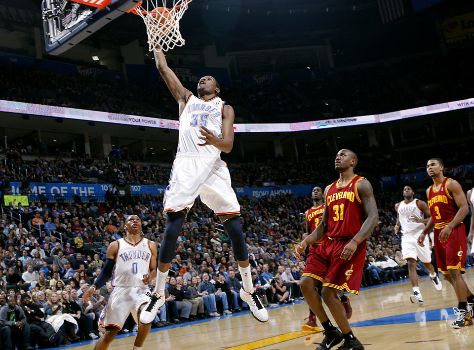 Photo - Oklahoma City's Kevin Durant puts up a shot against Cleveland during the first half of their NBA basketball game at the OKC Arena in Oklahoma City on Sunday, Dec. 12, 2010. Photo by John Clanton, The Oklahoman