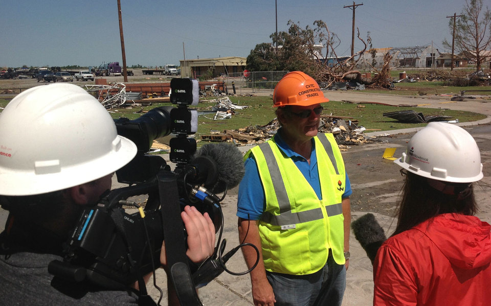 Photo - Greg Winters, superintendent of the Canadian Valley Technology Center, reviews storm recovery efforts with a TV news crew on Wednesday, June 5, 2013, at the tornado-ravaged El Reno, Okla., campus.     Provided