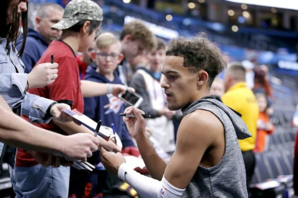 Photo -  Hawks guard Trae Young signs autographs for fans before Friday's game against the Thunder at Chesapeake Energy Arena. [Sarah Phipps/The Oklahoman]