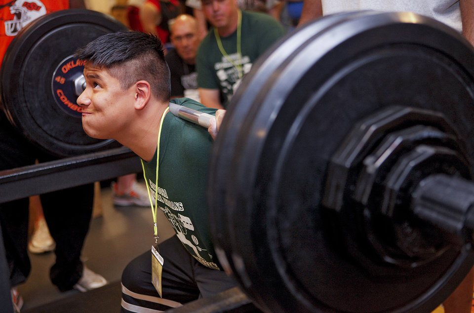 Edmond Joshua lifts the weight while doing the squat during the powerlifting competition for the Special Olympics at Oklahoma State University (OSU) on Wednesday, May 13, 2009, in Stillwater, Okla.   Photo by Chris Landsberger, The Oklahoman
