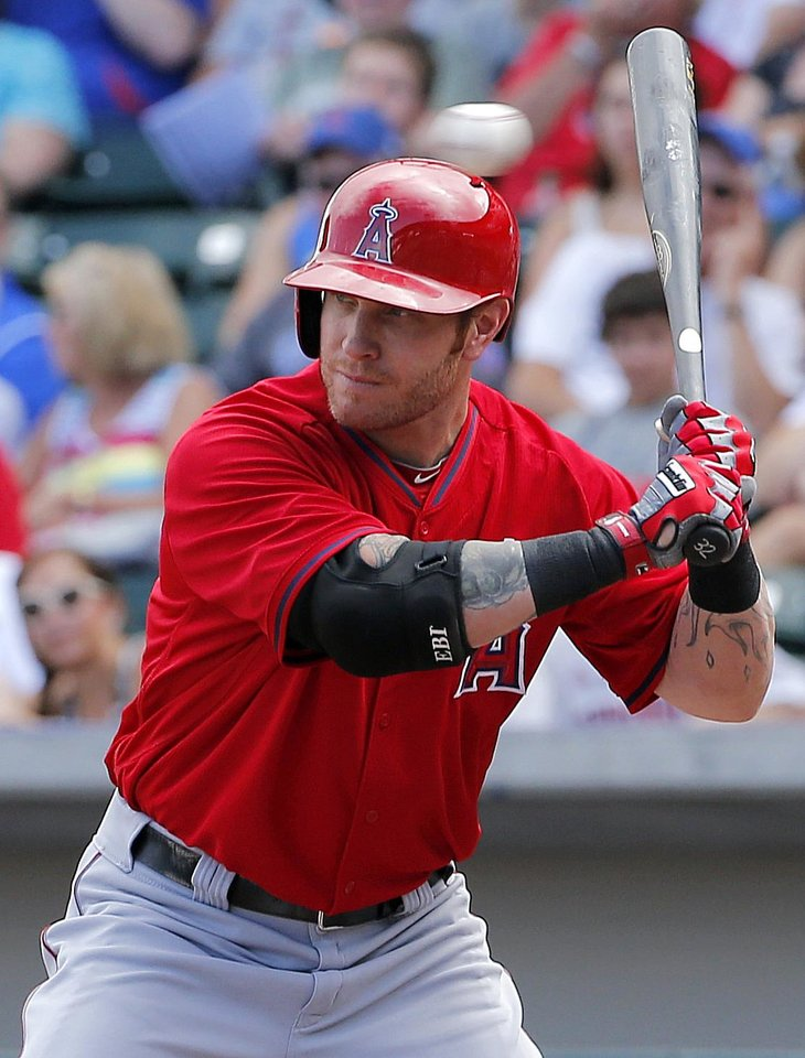 Photo - Los Angeles Angels' Josh Hamilton takes a high fastball against the Chicago Cubs' during the first inning of a spring training baseball game, Tuesday, March 25, 2014, in Mesa, Ariz. (AP Photo/Matt York)