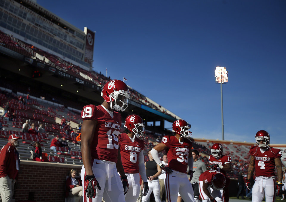 Photo - Oklahoma players warm up before the Bedlam college football game between the University of Oklahoma Sooners (OU) and the Oklahoma State University Cowboys (OSU) at Gaylord Family-Oklahoma Memorial Stadium in Norman, Okla., Saturday, Nov. 24, 2012. Photo by, Sarah Phipps The Oklahoman