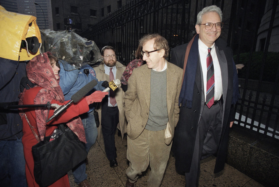 Photo - File- This Jan. 12, 1993 file photo shows director Woody Allen trading grins with a pursuing television reporter as he arrives at State Supreme Court in Manhattan, New York, for a hearing in which he requested more liberal visitation rights with his children during his ongoing dispute with ex-lover actress Mia Farrow. Dylan Farrow renewed molestation allegations against Allen, Saturday, Feb. 1, 2014, claiming the movie director sexually assaulted her when she was 7 after he and actress Mia Farrow adopted her. (AP Photo/Mario Cabrera, File)