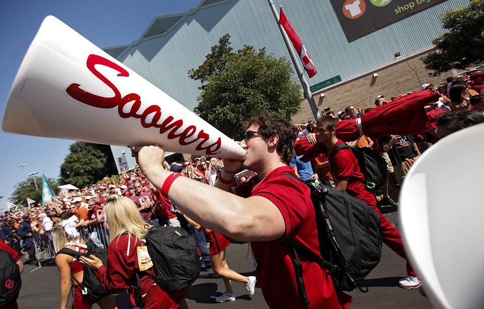 Photo - A member of the Oklahoma cheer squad yells in the bull horn as the team arrives for the Red River Rivalry college football game between the University of Oklahoma Sooners (OU) and the University of Texas Longhorns (UT) at the Cotton Bowl on Saturday, Oct. 2, 2010, in Dallas, Texas.   Photo by Chris Landsberger, The Oklahoman
