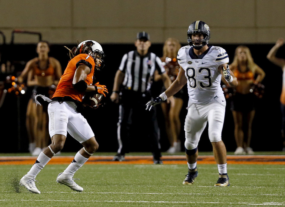 Photo - Oklahoma State's Ramon Richards (7) intercepts a pass in front of Pittsburgh's Scott Orndoff (83) in the final minute during a college football game between the Oklahoma State Cowboys (OSU) and the Pitt Panthers at Boone Pickens Stadium in Stillwater, Okla., Saturday, Sept. 17, 2016. Photo by Sarah Phipps, The Oklahoman