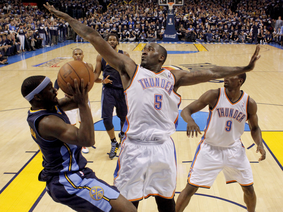 Photo - Oklahoma City's Kendrick Perkins (5) defends Denver's Ty Lawson (3) during the NBA basketball game between the Denver Nuggets and the Oklahoma City Thunder in the first round of the NBA playoffs at the Oklahoma City Arena, Wednesday, April 27, 2011. Photo by Bryan Terry, The Oklahoman