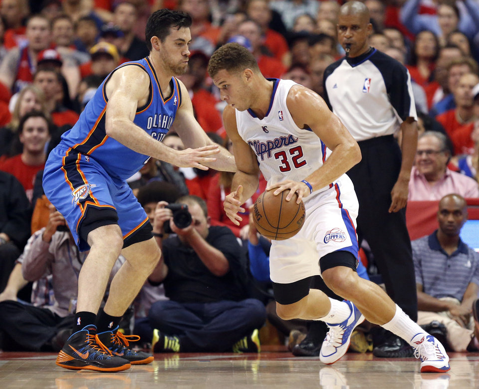 Photo - Los Angeles' Blake Griffin (32) drives to the basket as Oklahoma City's Nick Collison (4) defends during Game 3 of the Western Conference semifinals in the NBA playoffs between the Oklahoma City Thunder and the Los Angeles Clippers at the Staples Center in Los Angeles, Friday, May 9, 2014. Photo by Nate Billings, The Oklahoman