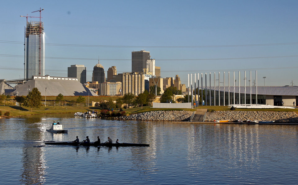 Competitors pass by the Oklahoma City skyline as they warm up before competition during the Oklahoma Regatta Festival at the Oklahoma River on Saturday, Oct. 1, 2011, in Oklahoma City, Okla. Photo by Chris Landsberger, The Oklahoman