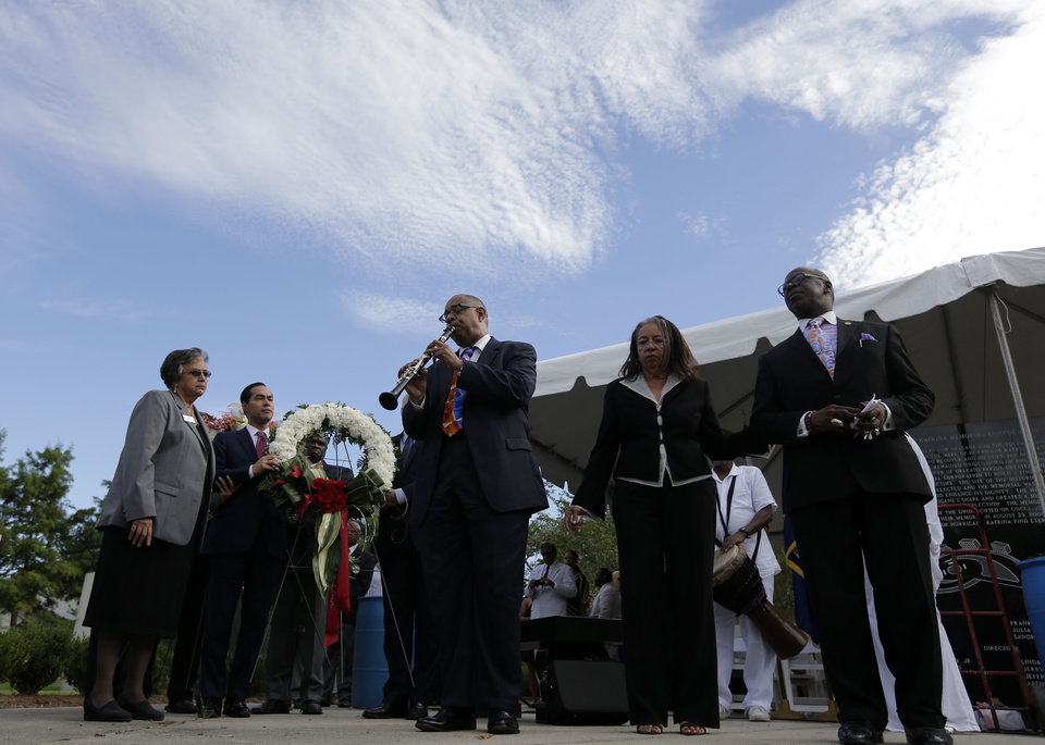 Photo - Dr. Michael White plays clarinet during a wreath-laying ceremony at the Hurricane Katrina Memorial, on the ninth anniversary of the storm, in New Orleans, Friday, Aug. 29, 2014. (AP Photo/Gerald Herbert)