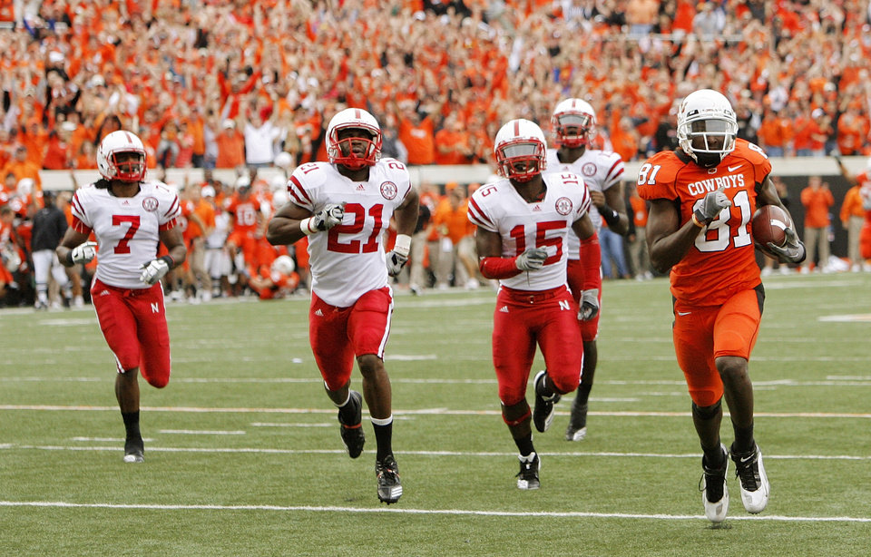 Photo - OKLAHOMA STATE UNIVERSITY: OSU's Justin Blackmon (81) leaves behind Nebaska defenders, including DeJon Gomes (7), Prince Amukamara (21) and Alfonzo Dennard (15) on an 80-yard touchdown catch in the second quarter during the college football game between the Oklahoma State Cowboys (OSU) and the Nebraska Huskers (NU) at Boone Pickens Stadium in Stillwater, Okla., Saturday, Oct. 23, 2010. Photo by Nate Billings, The Oklahoman