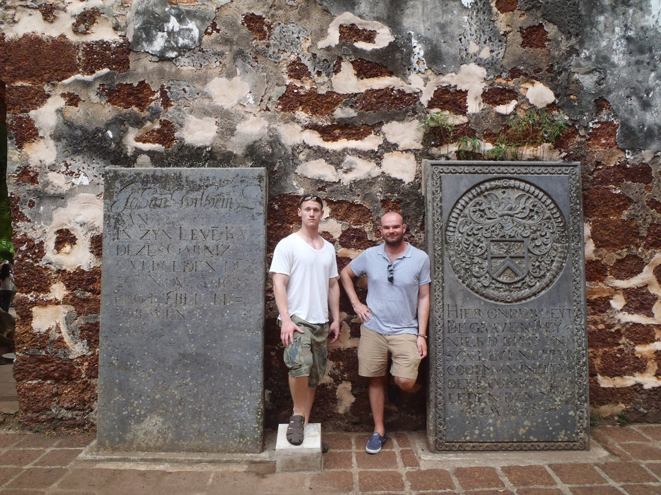 Photo - This 2012 photo provided by Jeremy Hanson shows Hanson, left, and a friend, Stephen Conroy, in Malacca, Malaysia, where they hired a private tour guide to take them around. Hanson often hires local guides to give personal tours when he travels. Private tours are a growing industry around the world, no longer the exclusive domain of wealthy travelers.  (AP Photo/Jeremy Hanson, Stephen Conroy)