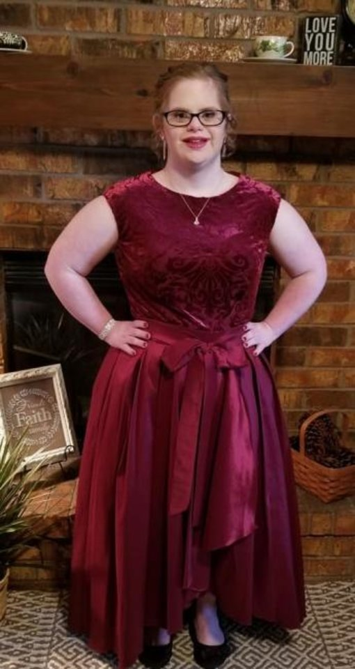 Photo -  Breanna Robison poses in her burgundy formal gown before attending the Night to Shine prom, hosted by the Tim Tebow Foundation. [PHOTO PROVIDED]
