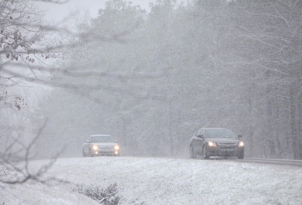 Photo - Vehicles move along Hwy 86 in Carrollton, Ala. Thursday, Jan. 17, 2013. A wet blanket of snow covered much of West Alabama Thursday morning.  (AP Photo/The Tuscaloosa News, Dusty Compton)