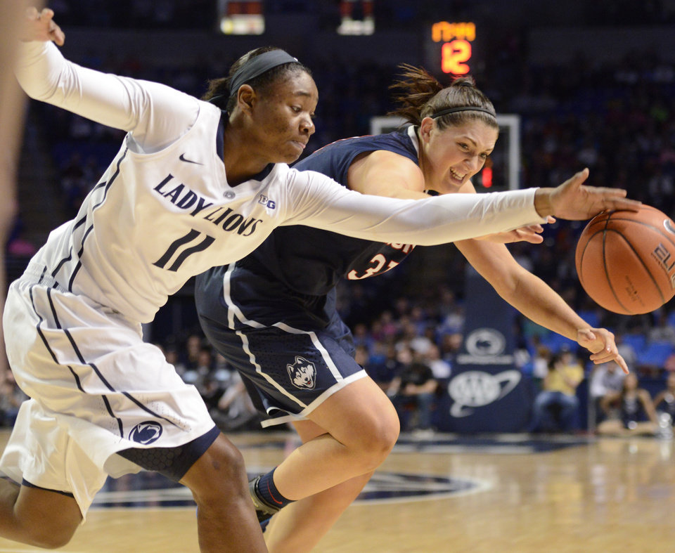 Photo - Penn State's Alex Harris (11) and Connecticut's Stefanie Dolson (31) go after a loose ball in the second half of an NCAA college basketball game on Sunday, Nov. 17, 2013, in State College, Pa. Connecticut won 71-52. (AP Photo/John Beale)