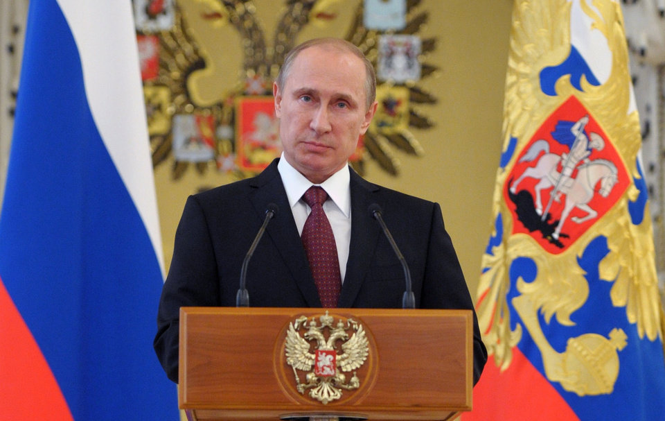 Photo - FILE - In this June 26, 2014, file photo, Russian President Vladimir Putin addresses graduates of military academies in Moscow's Kremlin. In a statement published on the Kremlin website on Friday, July 4, 2014, Putin said