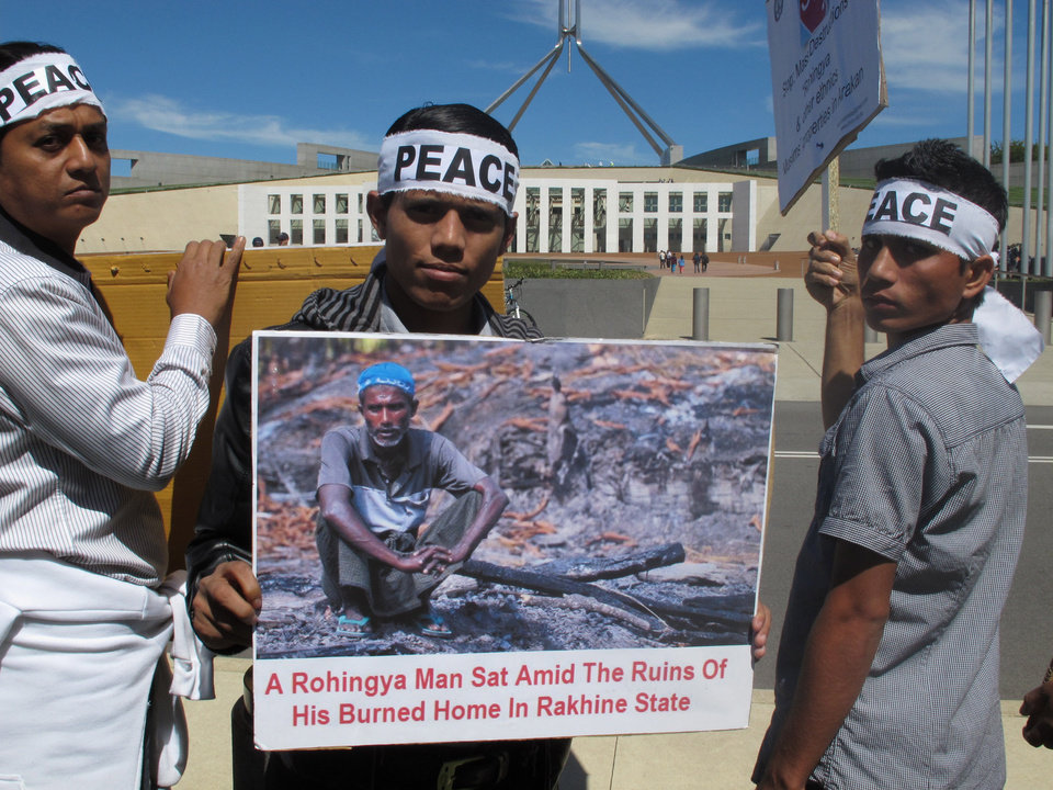 Ethnic Rohingya protesters demonstrate against a visit by Myanmar President Thein Sein outside Parliament House in Canberra, Australia, on Monday, March 18, 2013. The first Myanmar leader to visit Australia since 1974, Thein Sein joined Australian Prime Minister Julia Gillard for a news conference where she announced it will restore limited military cooperation and increase business ties with the Southeast Asian country, which ended five decades of military rule in 2011. (AP Photo/Rod McGuirk)