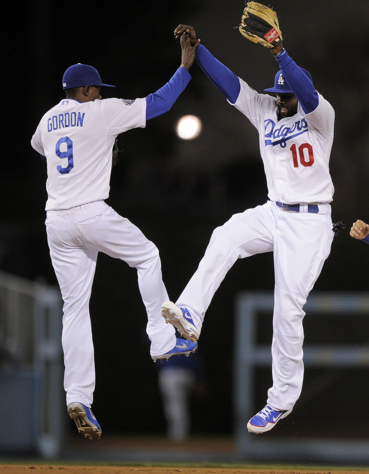 Los Angeles Dodgers shortstop Dee Gordon, left, and left fielder Tony Gwynn celebrate after defeating the Pittsburgh Pirates during in their baseball game, Thursday, April 12, 2012, in Los Angeles. The Dodgers won 3-2. (AP Photo/Mark J. Terrill)