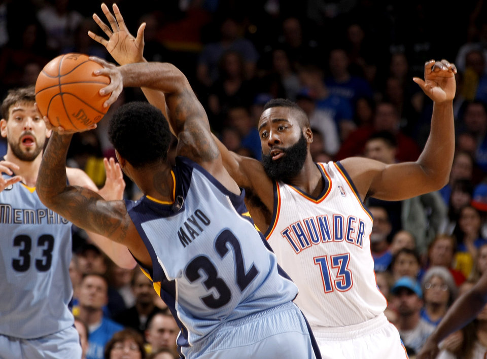 Oklahoma City\'s James Harden (13) defends Memphis\' O.J. Mayo (32) during the NBA game between the Oklahoma City Thunder and the Memphis Grizzlies at Chesapeake Energy Arena in Oklahoma CIty, Friday, Feb. 3, 2012. Photo by Bryan Terry, The Oklahoman