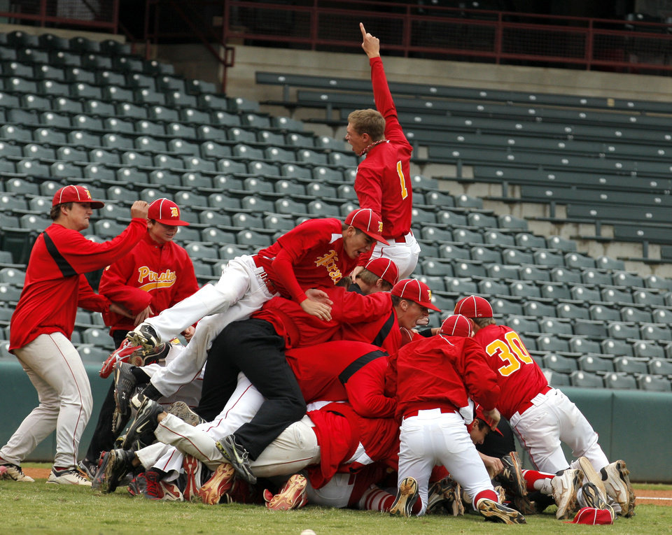 Photo - Dale celebrates their win over Latta in the Class A Fall baseball state at the Chickasaw Bricktown Ballpark in Oklahoma City,  Saturday, Oct. 6, 2012. Photo by Sarah Phipps, The Oklahoman