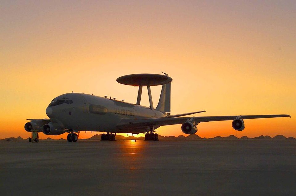 Photo - PLANE, AIRPLANE: An E-3 AWACS aircraft from Tinker Air Force Base takes off at sunset in Southwest Asia for a mission to support Operation Enduring Freedom . (U.S. Air Force photo/Staff Sgt. Matthew Hannen)  Released.  VIRIN: 030312-F-9528H-002