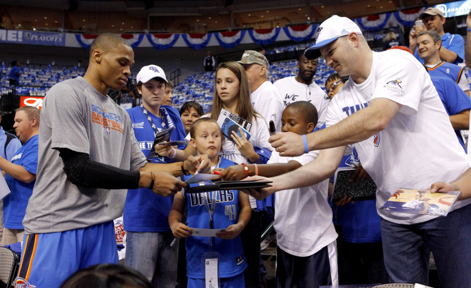 Oklahoma City's Russell Westbrook signs autographs before game 2 of the Western Conference Finals in the NBA basketball playoffs between the Dallas Mavericks and the Oklahoma City Thunder at American Airlines Center in Dallas, Thursday, May 19, 2011. Photo by Bryan Terry, The Oklahoman