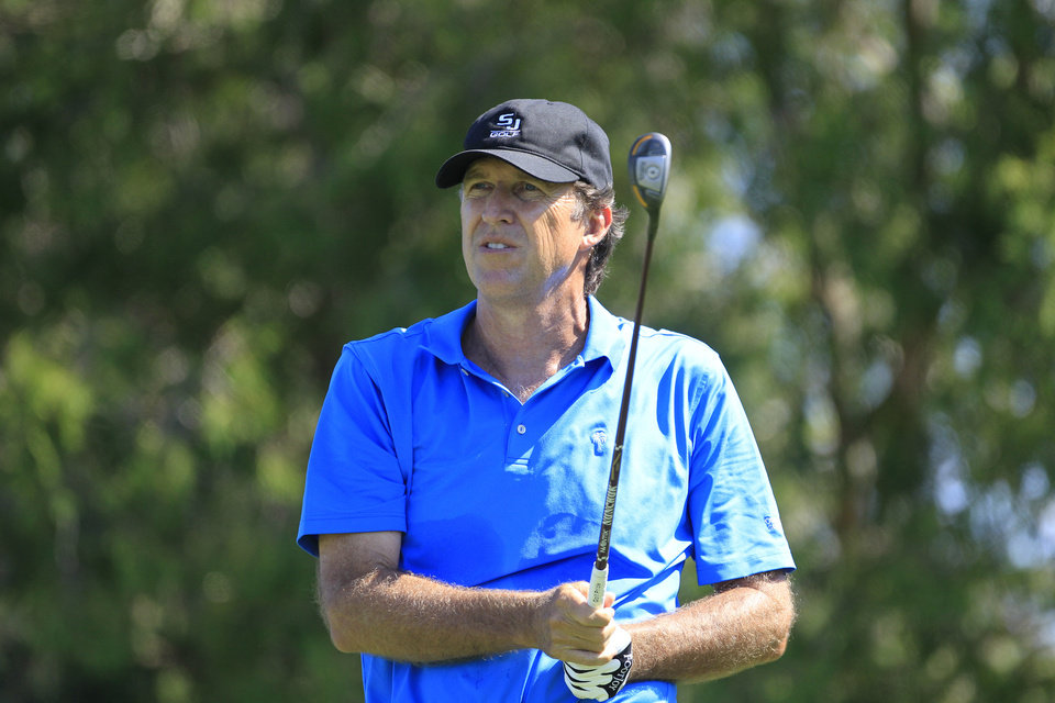 Photo -   Steve Jone watches his drive on the tenth hole during the first round at the U.S. Senior Open golf tournament at the Indianwood Golf and Country Club in Lake Orion, Mich., Thursday, July 12, 2012. (AP Photo/Carlos Osorio)