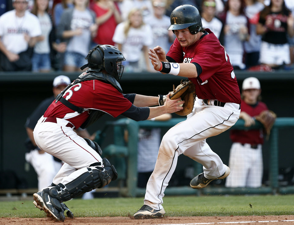 Photo - Dewey's Trevor Hudgens tags out Tuttle's Dalton Secrist during the class 4A state baseball championship game between Tuttle and Dewey at the Chickasaw Bricktown Ballpark in Oklahoma City, Saturday, May 17, 2014. Photo by Sarah Phipps, The Oklahoman