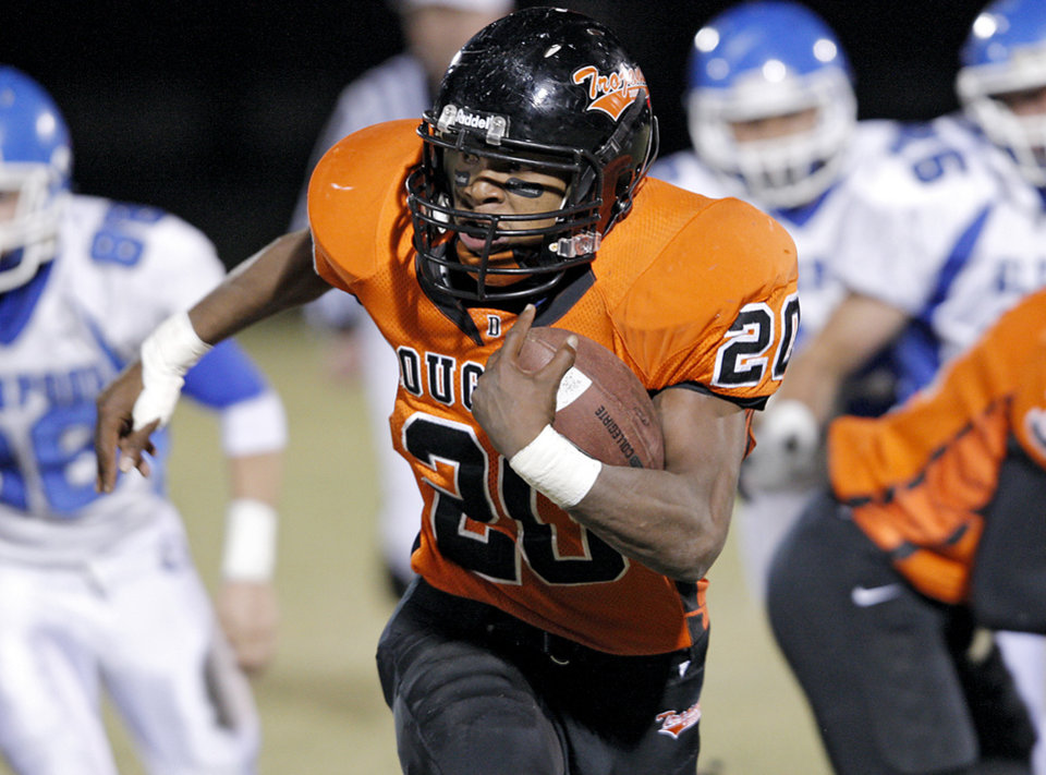 Douglass' Aliston Cobb leads Glenpool defenders as he takes the ball downfield during their game at Moses F. Miller Stadium at Douglass High School in Oklahoma City on Friday, Oct. 29, 2010. Photo by John Clanton, The Oklahoman