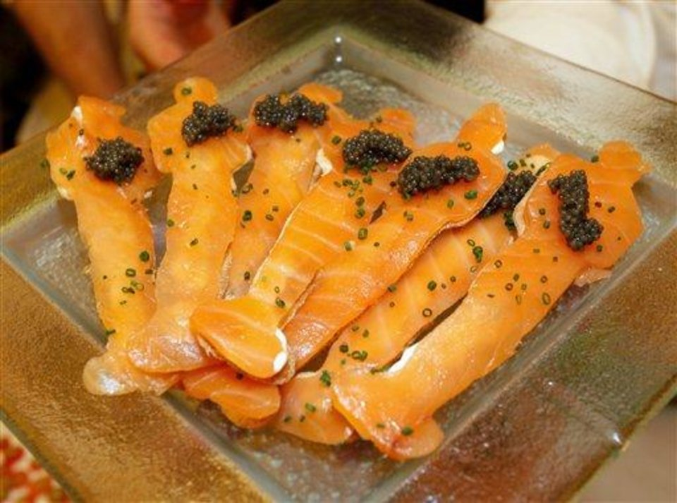 Master Chef Wolfgang Puck's classic dish, smoked salmon on Oscar fatbread with Caviar is displayed for the 84th Annual Academy Awards Governors Ball at the Oscar food and beverage preview at the Kodak Theatre in Los Angeles on Thursday, Feb. 23, 2012.  The Academy Awards will be held on Sunday. (AP Photo/Damian Dovarganes)
