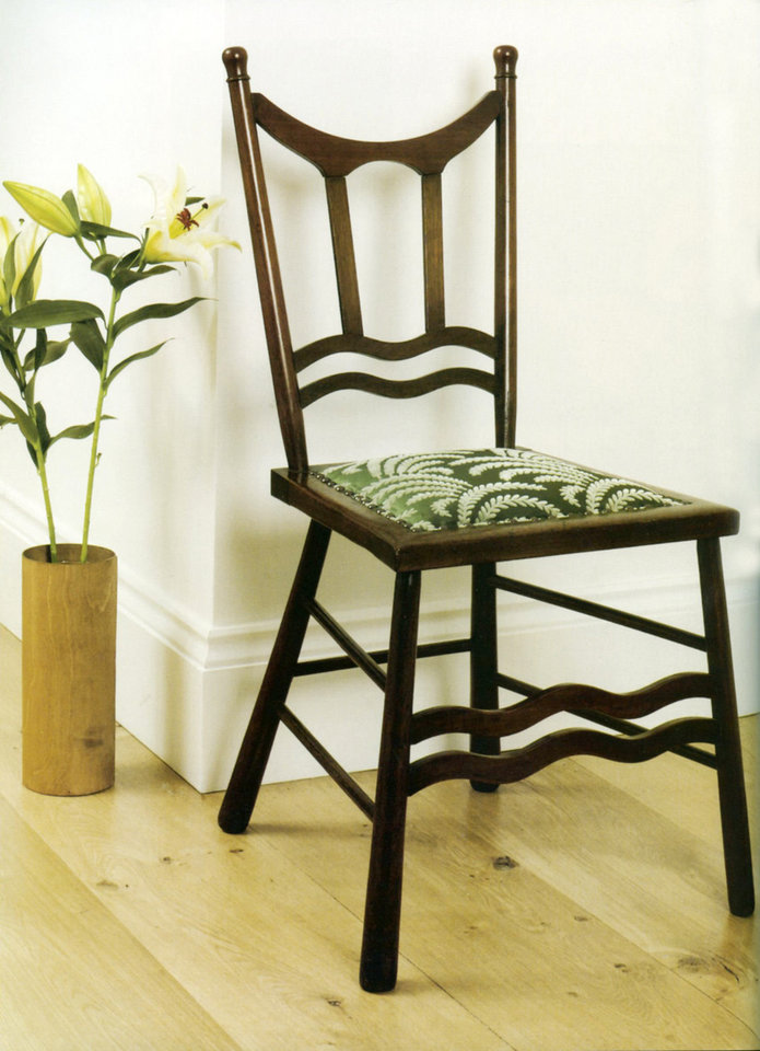 "This chair was reupholstered and refinished, giving it a fresh, new look. Photo from ""The Upholsterer's Handbook,"" by Nicole Fulton with Stuart Weston.   <strong>Prepress</strong>"