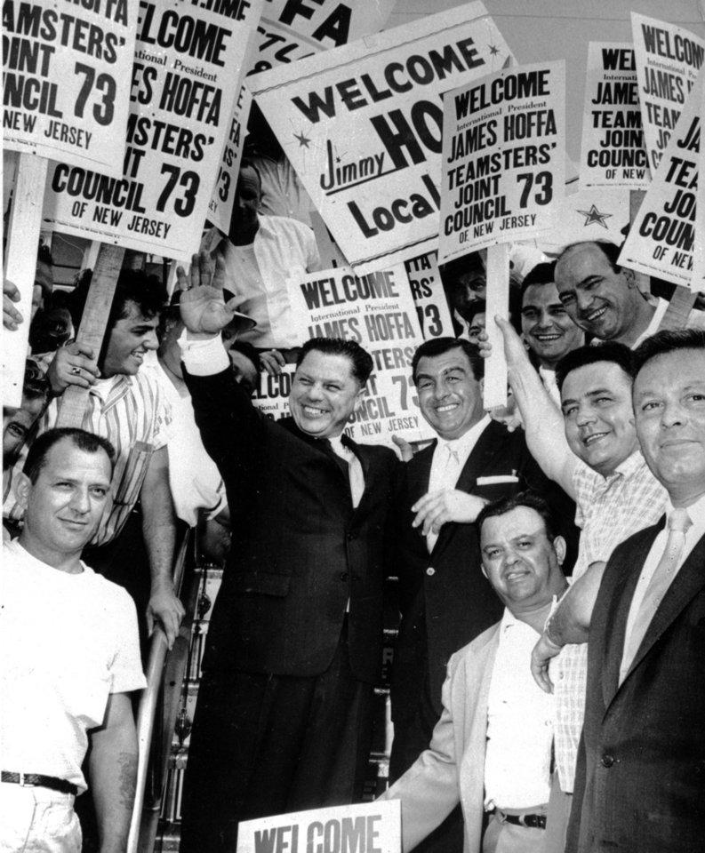 Photo -   FILE - This undated photo shows Teamsters Union President James R. Hoffa, left, stands with Anthony Provenzano, right, and fellow union members during Hoffa's visit to New Jersey. A self-described mafia murderer who served prison time with Hoffa told a U.S. Senate committee that the teamsters boss was killed at Provenzano's orders. (AP File Photo)