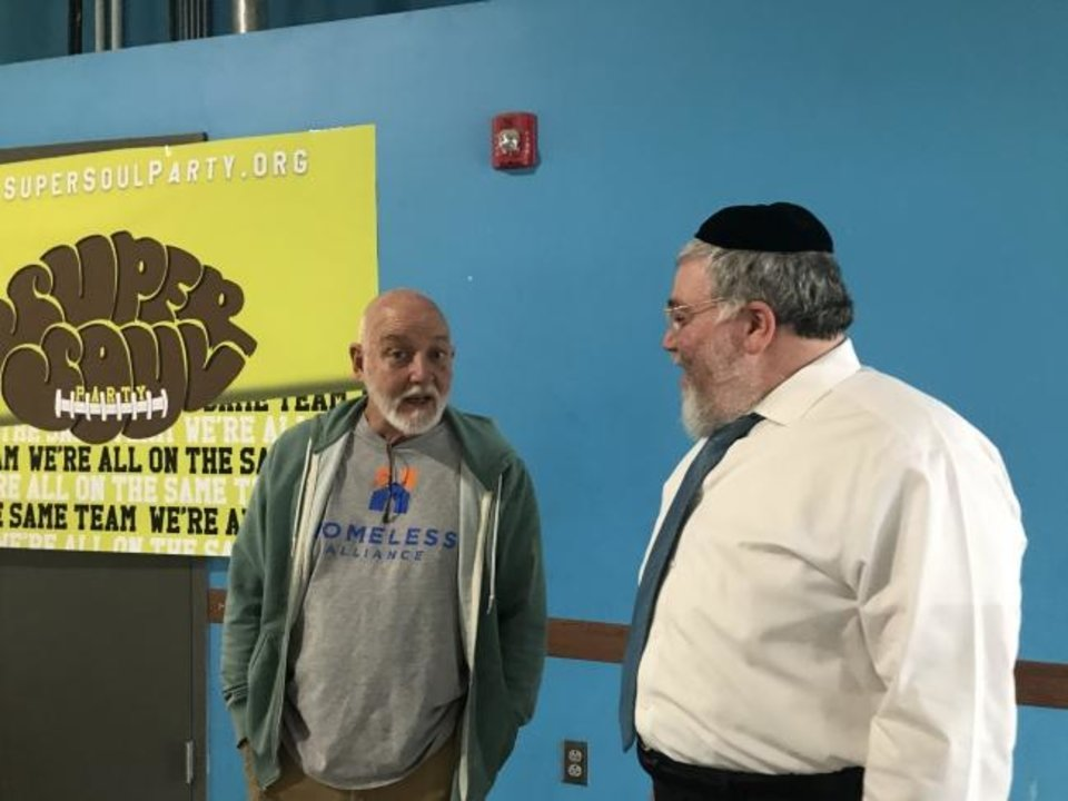 Photo -  Dan Straughan, executive director of the Oklahoma City Homeless Alliance, talks with Rabbi Ovadia Goldman, spiritual leader of the Chabad Community Center for Jewish Life and Learning, during Chabad's Super Soul Party at the homeless alliance's day shelter, 1724 NW 4. [Carla Hinton/The Oklahoman]