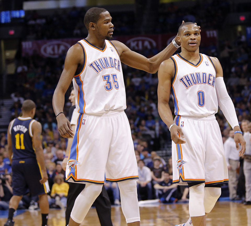 Oklahoma City Thunder\'s Kevin Durant (35) pats Oklahoma City Thunder\'s Russell Westbrook (0) on the head as they walk off the court during the NBA basketball game between the Oklahoma City Thunder and the Utah Jazz at Chesapeake Energy Arena on Wednesday, March 13, 2013, in Oklahoma City, Okla. Photo by Chris Landsberger, The Oklahoman