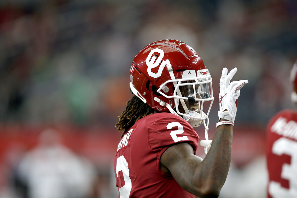 Photo - Oklahoma's CeeDee Lamb waves to the crowd before the Big 12 Championship Game between the University of Oklahoma Sooners (OU) and the Baylor University Bears at AT&T Stadium in Arlington, Texas, Saturday, Dec. 7, 2019. [Bryan Terry/The Oklahoman]