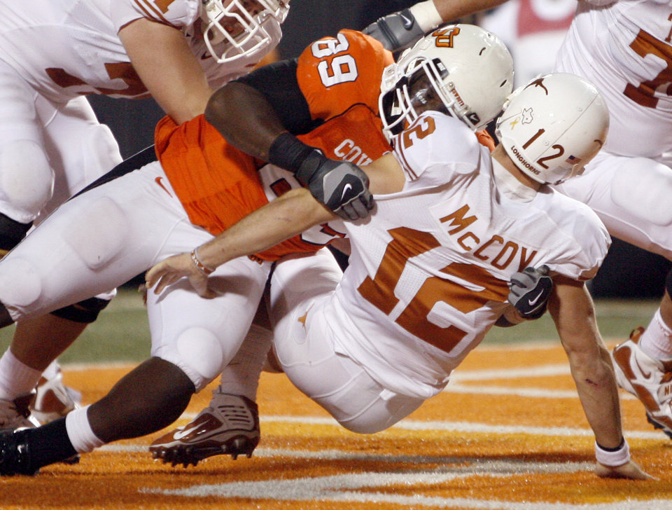 Photo - OSU's Nigel Nicholas  (89) puts pressure on Texas quarterback Colt McCoy (12) during the college football game between the Oklahoma State University Cowboys (OSU) and the University of Texas Longhorns (UT) at Boone Pickens Stadium in Stillwater, Okla., Saturday, Oct. 31, 2009. Photo by Sarah Phipps, The Oklahoman